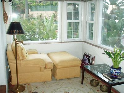 Sunroom reading room with full ocean view.
