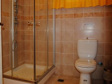 Full bathroom with jetted shower in the lower level of the villa
