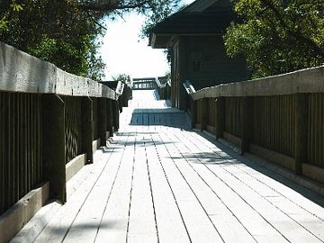Walk way to beach- with showers and bathrooms - walk or bike to beach!