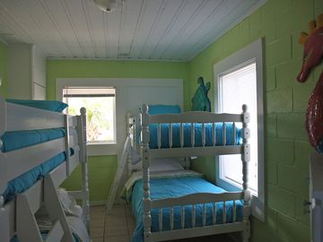 Kids room with TV and 2 sets of bunk beds