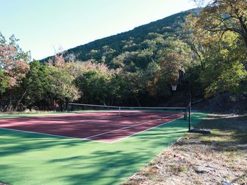 Tennis court and basketball goal