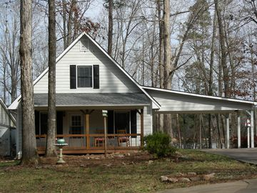 Lake West Point cottage rental - Front Elevation with Rocking Chair Front Porch and A Swing TOO!