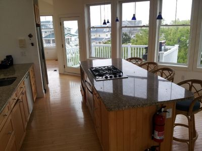 Kitchen with view. Granite counter tops with high-end stainless appliances.