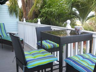 Key West condo photo - Balcony overlooks the ocean and sunset.