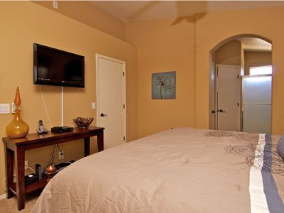 "Master Bedroom w/ walk-in closet, 36"" HD TV, Blu-Ray Player & Private Bathroom."