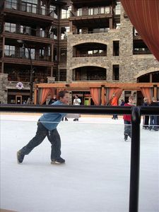 Ice skating rink surrounded by shops and restaurants in Northstar Village