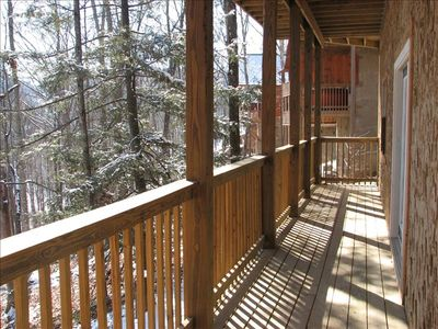 Enjoy the wooded view from the lower porch.