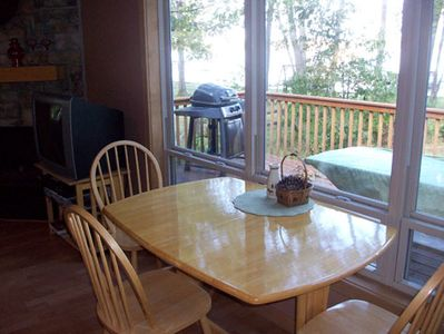 Pellston cottage rental - Additional dining table and chairs with view looking out onto the lake
