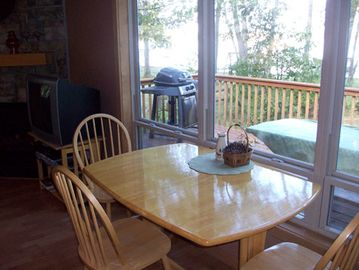 Additional dining table and chairs with view looking out onto the lake