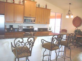 Cape Coral house photo - Granite&Stainless Steel, 4 stools, 4 table, loaded with dishes & supplies