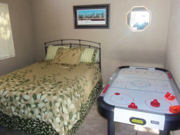 Bedroom 3. With air hockey table.