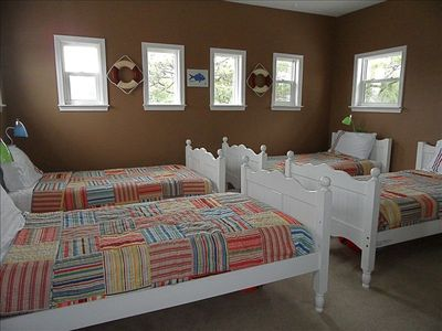 Third floor tower room with 4 twin beds...makes for a great kids room
