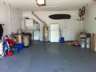 New Smyrna Beach house photo - Oversized garage with beach chairs, carts, umbrellas and room to park your car.