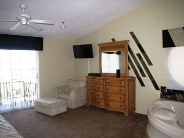Master bedroom w/ balcony, large LCD HDTV, en suite jacuzzi tub...