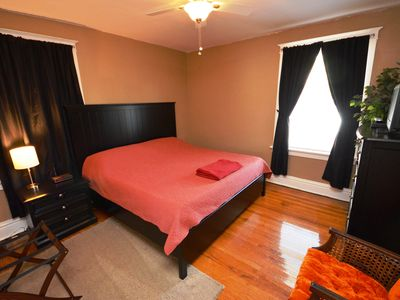 "Bedroom with king sized bed, memory foam mattress and 20"" TV."