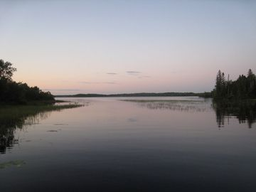 Cabin is located in a quiet bay, seen here at dusk