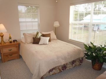 1 of 4 Queen Bedrooms. All bedrooms have Cable/TV/DVD Players and Alarm clocks.