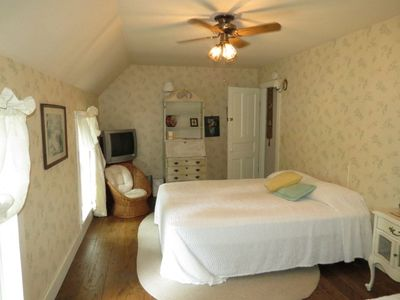 Large Upstairs Bedroom, on front of home w/ Queen bed w/ dressing room. Cable TV