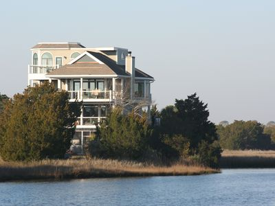 House across the lagoon with it's new siding.