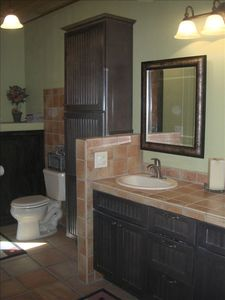 Master bath with two sinks and steam shower.