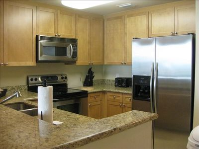 Fully equipped kitchen with new stainless steel appliances