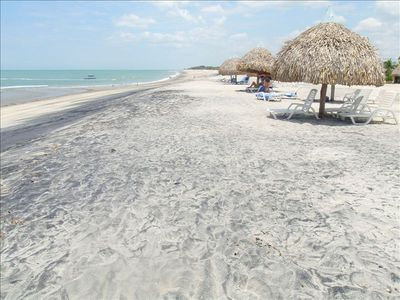 Miles of white, sandy beach with private, thatched roof bohios for your use