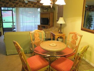 Dine here or on the screened lanai - North Naples condo vacation rental photo