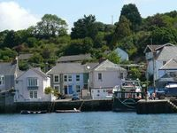 A Fishermans cottage just metres from the waters edge in village