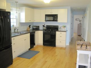 Dennis Village house photo - fully applianced kitchen with view of hallway to two bedrooms and main bath