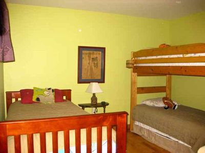 The bunk room includes a trundle bed, loft and twin bed to sleep 4 comfortably.