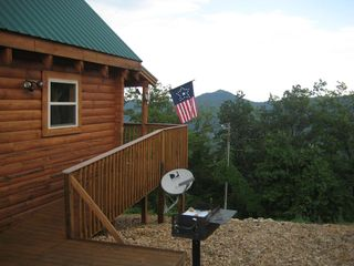 Wears Valley cabin photo - View facing east (toward Gatlinburg) with charcoal grill & wheelchair ramp