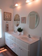Harbor Island house photo - Second floor private master bath offers a tub/shower combo. and double sinks.