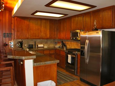 Kings Beach lodge rental - Fully stocked kitchen with Kitchen Aid appliances, bar for 5, deck w table