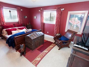 "Lg 2nd bdrm w/ king sleigh bed. This is our ""romantic red bedroom"" w/flatscreen"