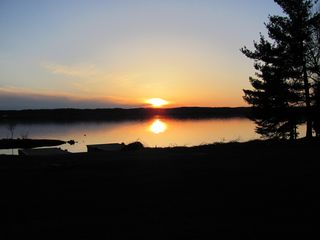 Lake Leelanau cottage photo - Enjoy beautiful sunsets from the back patio.