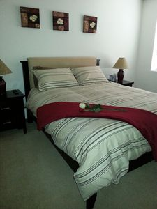 Large master bedroom features queen bed, attached bath and walk in closet.