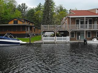Unit 7 with waterfront deck, private enclosed patio and 30 foot boat slip - Alton Bay condo vacation rental photo