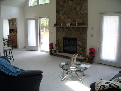 Living Room with propane gas fireplace. Warm up with the flick of a switch!