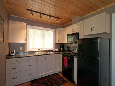 Nakusp studio rental - The immaculate kitchen area is fully equipped for your meal preparation.