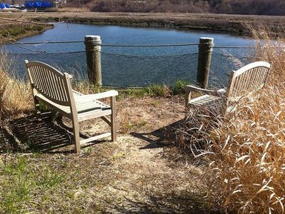 SIT AND RELAX IN THE CHAIRS OVERLOOKING THE PRIVATE BOAT DOCKS AND HARBOR INLET.