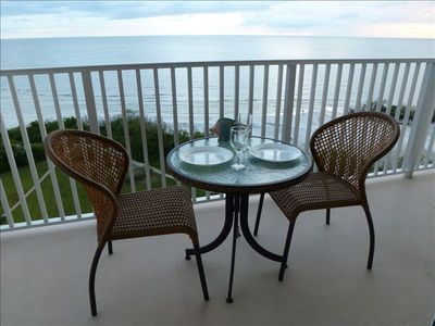 Comfortable chairs and dining table on the balcony to enjoy beautiful sunsets.