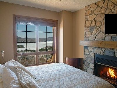 Bedroom with fireplace and amazing views
