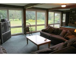 North Conway house photo - View of backyard from second living room - small pool table in background