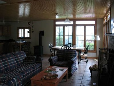 Great room with fireplaces, wet bar & refrig, dining and water views