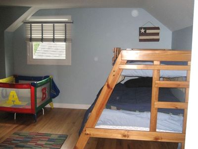 bunk with double bed on the bottom in the same room