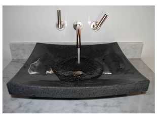 Newport house photo - Stone Forest, hand carved granite sink with Dornbracht titanium bath fixtures.