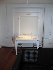 Vancouver apartment photo - Murphy Bed upright with Dining Table folded out