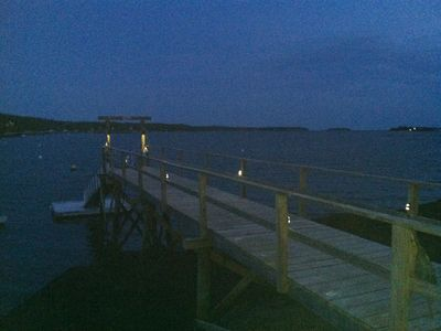 Pier at night with solar lighting for safety.