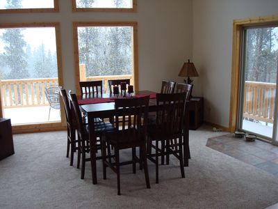 Dining adjacent to open kitchen and living room. Main level. Door to deck.