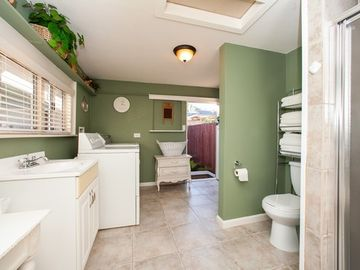Guest House Bathroom with Washer and Dryer